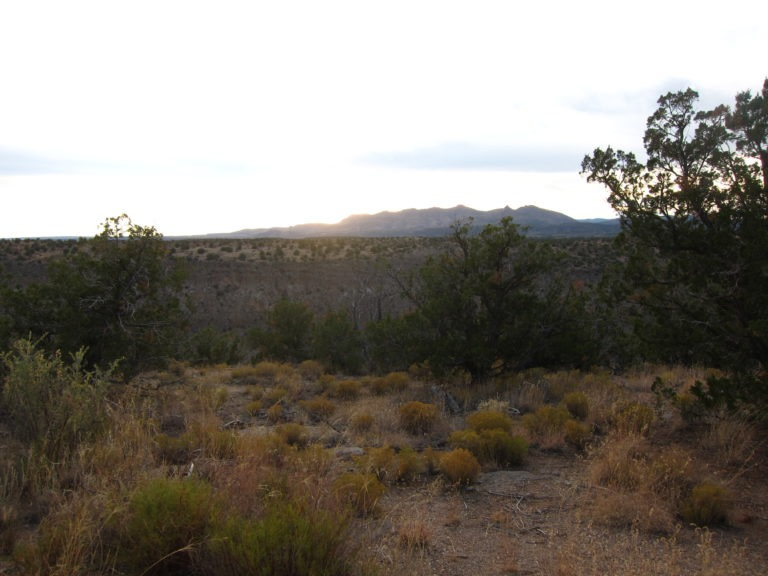 sunset over distant mountain in New Mexico
