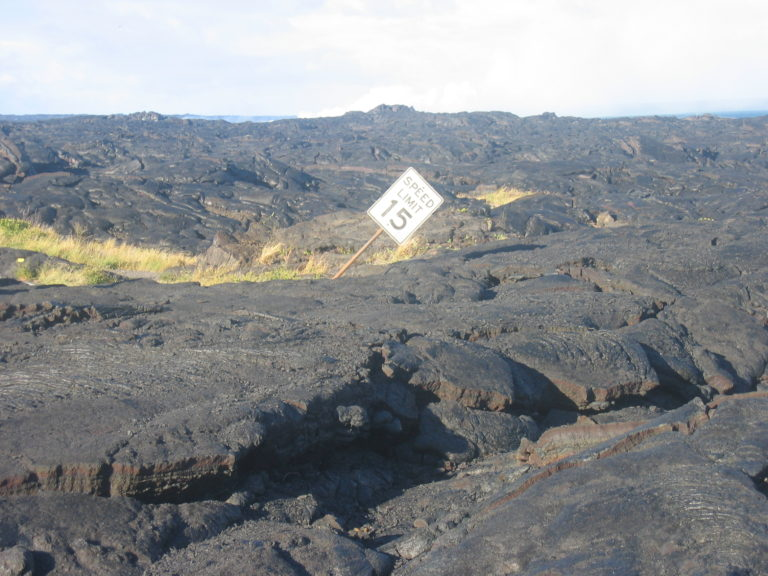 famous speed limit sign stuck in dried lava on Chain of Craters Road 2005
