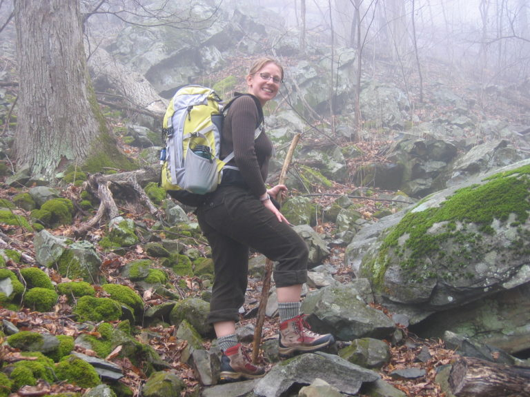 Kelly Fisher hiking on rocks in Shenandoah National Park