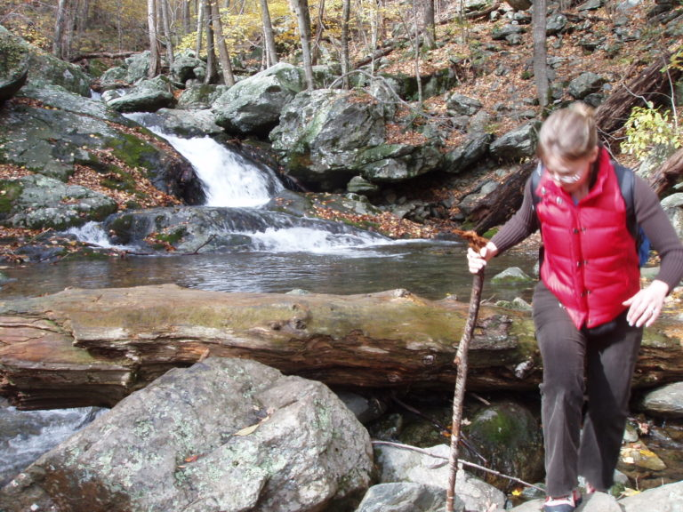 Kelly Fisher crossing a stream in Shenandoah National Park