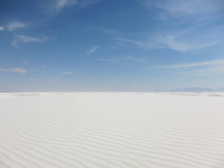 panoramic image of flat sand at White Sands National Monument