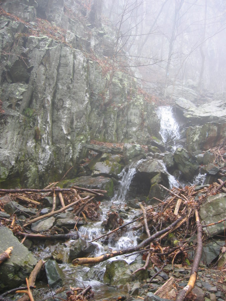 a waterfall in mist