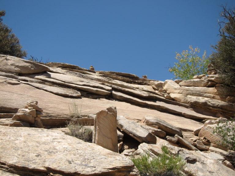 rock cairns on a steep scrambling climb