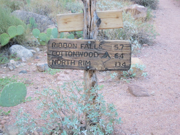 mileage sign reading Ribbon Falls 5.7 Cottonwood 6.4 North Rim 13.4