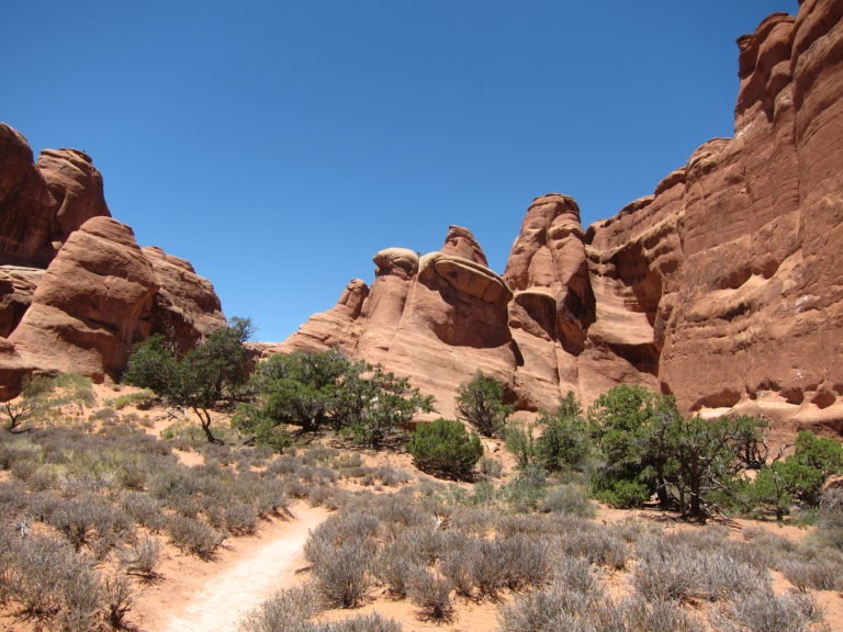 trail to Devils Garden Campground by large rock walls