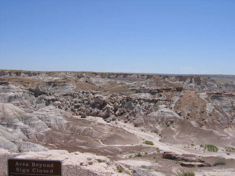 rocky badlands beyond a closed sign in Petrified Forest National Park