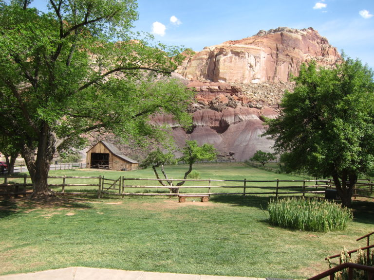 a small barn by the Gifford House in Fruita with rock walls in the background