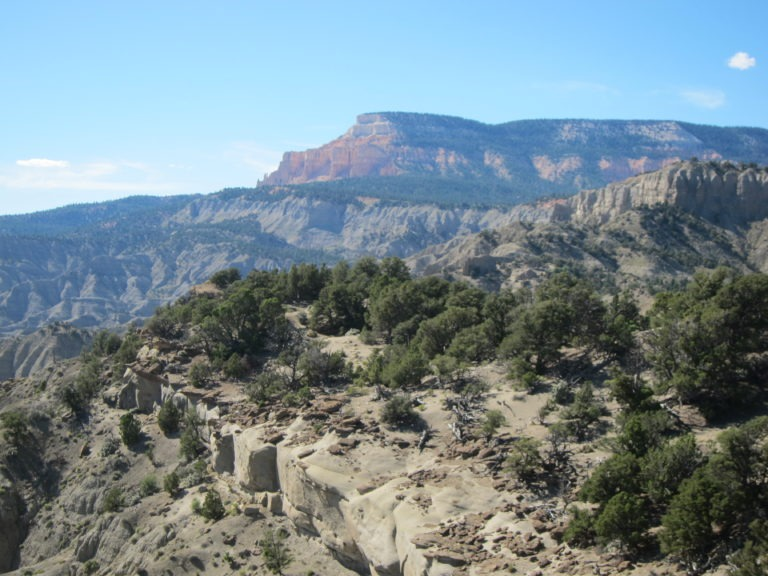 photo of red cliffs and gray slickrock in Grand Staircase