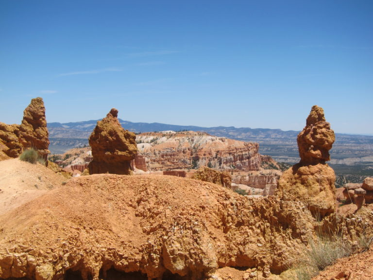 three hoodoos pictured against the blue sky in Bryce Canyon