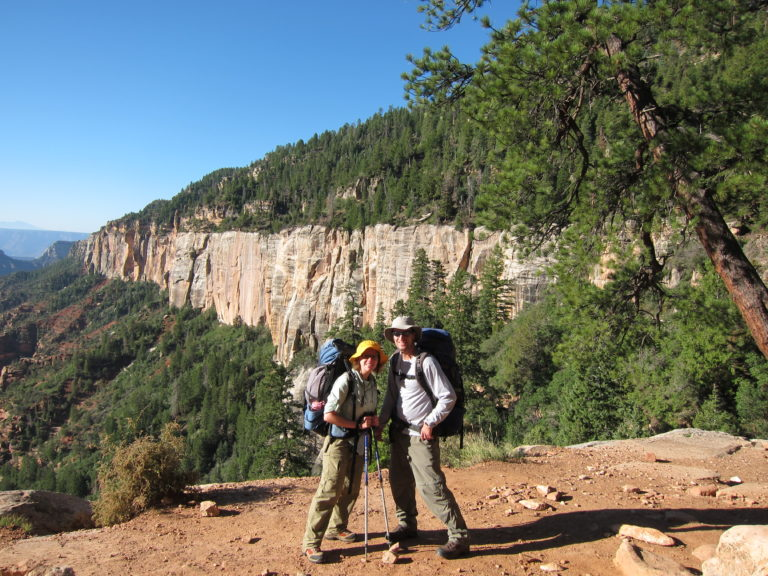 Joe and Kelly Fisher standing at the North Rim ready to hike