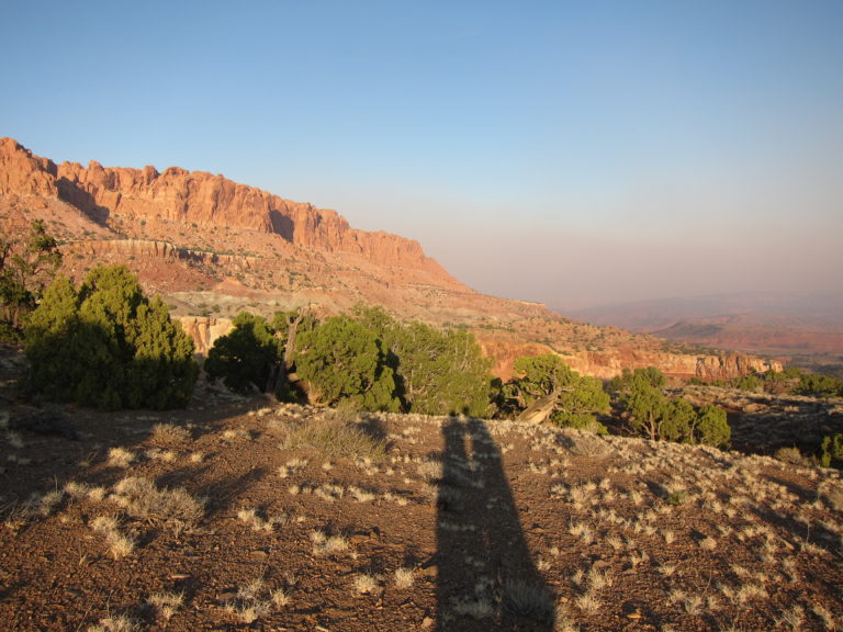 wildfire smoke drifting through Capitol Reef as the sun sets