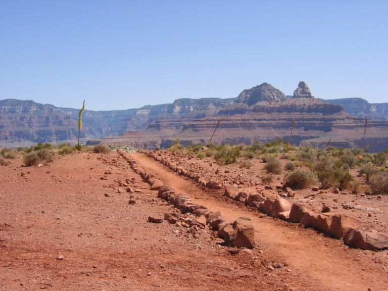 flat section of the South Kaibab Trail heading to a steep decline in the distance